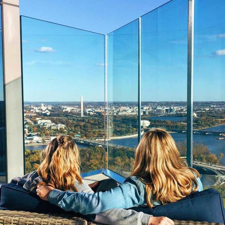 @annatheacook - Women at the top of the CEB Tower Observation Deck overlooking fall foliage in Washington, DC